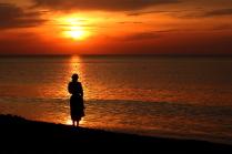 На закате у моря