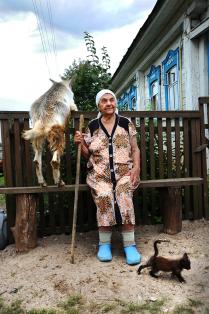 Goat, kitten and Baba Valya.