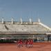 Юноши на стадионе.