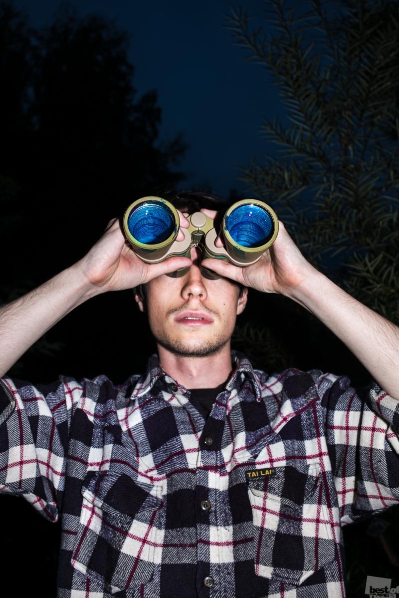 Self-portrait with binoculars